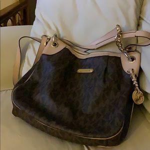 Bag with long adjustable strap and shoulder strap